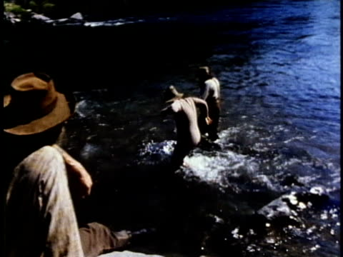 1850s reenactment montage gold prospectors jumping into river, usa, audio - gold rush stock videos and b-roll footage