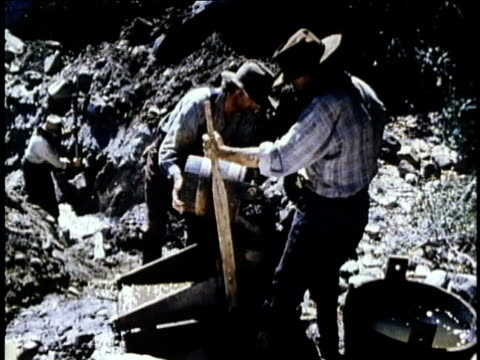 1850s reenactment montage gold prospectors using cradle to separate gold from soil, usa, audio - gold rush stock videos and b-roll footage