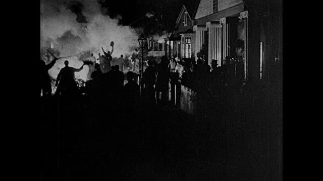 1850s town celebrates with a bonfire - xix secolo video stock e b–roll