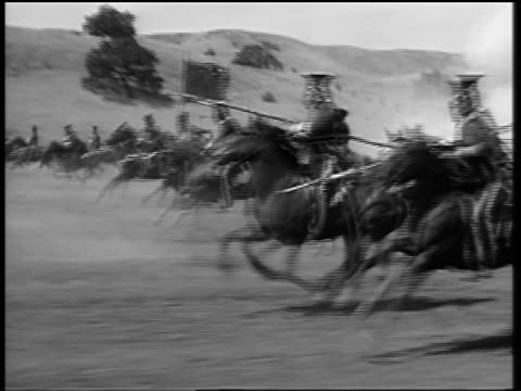 b/w 1850s tracking shot british light brigade soldiers with weapons riding running horses amidst explosions - war stock videos and b-roll footage