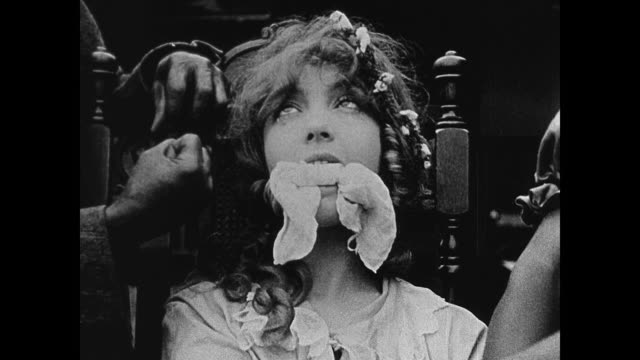 1860s A woman (Lillian Gish) is held captive