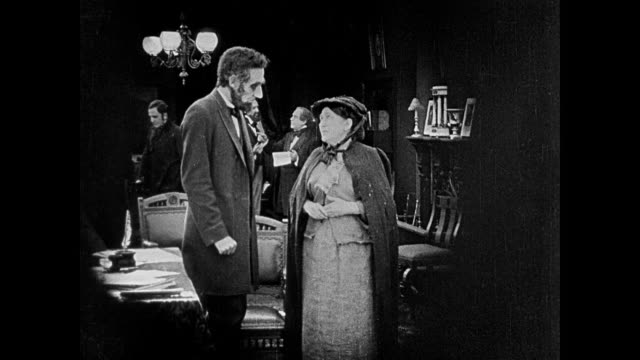 1860s Abraham Lincoln (Joseph Henabery) greets two woman (Lillian Gish and Josephine Crowel) who seek his help