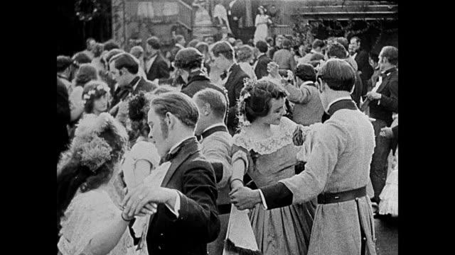 1860s Civil war era men and women dance at a luxurious affair
