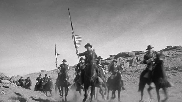 1870s reenactment low angle us cavalry brigade on horseback riding down western trail - cavalry stock videos & royalty-free footage