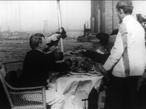 b/w 1890s 2 couples having fancy meal on yacht cruising on east river / nyc / newsreel - 1890 1899 stock videos & royalty-free footage