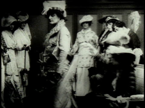 1962 montage 1890s debutantes modeling different dresses / united states - xix secolo video stock e b–roll