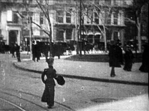b/w 1890s trolley point of view on city street going around corner / nyc / newsreel - tram stock videos & royalty-free footage
