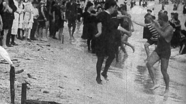 1890s wide shot couples performing cakewalk dances on beach - 19th century stock videos & royalty-free footage