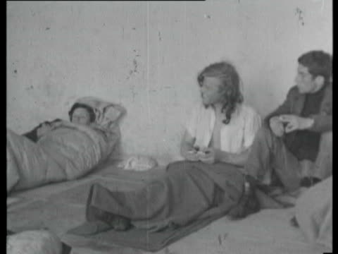 18may1965 b/w montage young people lying in sleeping bags on pavement / united kingdom - teenage boys stock videos & royalty-free footage