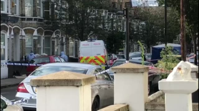 18yearold stabbed to death in lambeth england london lambeth ext police tape cordon across street forensic officers next to police van on other side... - lambeth stock videos & royalty-free footage