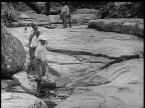 b/w 1900s black men clearing debris from ditch in panama canal construction / documentary - panama canal stock videos & royalty-free footage
