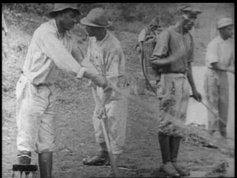 b/w 1900s black men digging in panama canal construction / documentary - panama canal stock videos & royalty-free footage