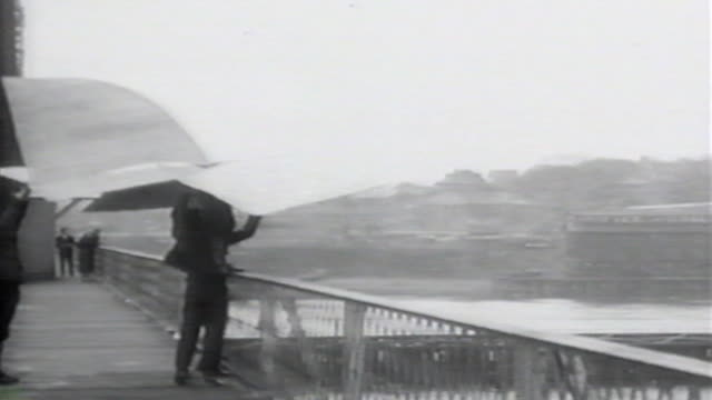 1900s b/w montage glider is launched from bridge and crashes / united states - hang gliding stock videos & royalty-free footage