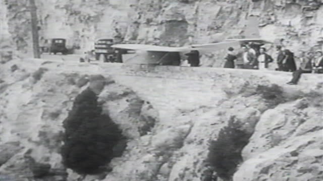 1900s b/w montage man goes over cliff in glider and crashes / united states - 1900 stock videos & royalty-free footage