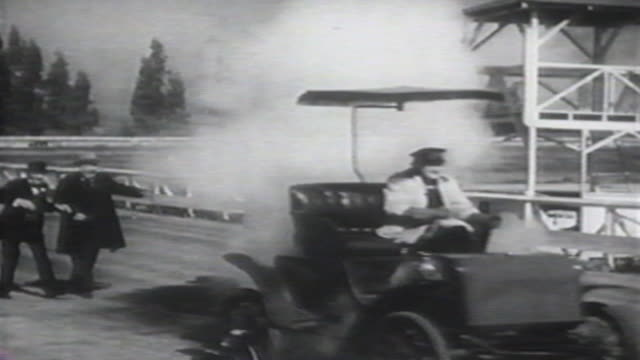 1900s b/w montage man in his car races horse and buggy / united states - film montage stock videos & royalty-free footage