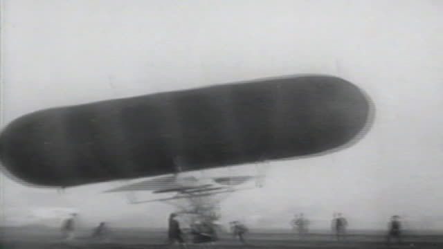 1900s b/w montage men try to control flying machine with spinning blades / united states - air vehicle stock videos & royalty-free footage