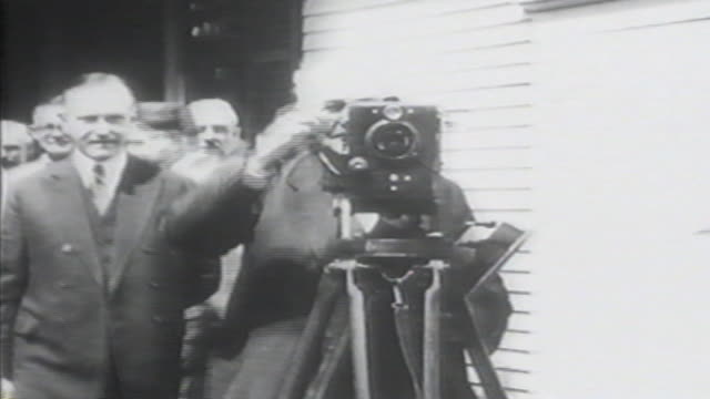 1900s b/w montage thomas edison operates movie camera also tight shot of his head / united states - film camera stock videos & royalty-free footage
