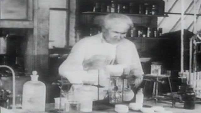 stockvideo's en b-roll-footage met 1900s b/w montage thomas edison works in his lab and turns on light bulb / united states - electric lamp