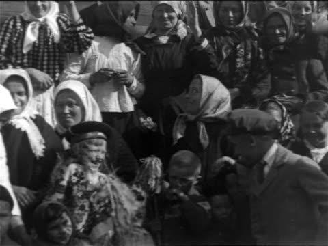 B/W 1900s close up PAN crowd of immigrants smiling posing for camera / NYC / newsreel
