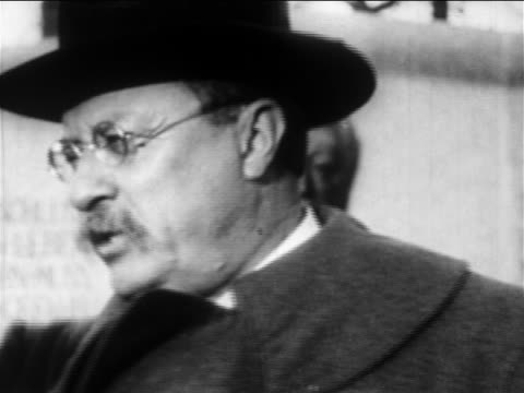b/w 1900s close up theodore roosevelt in hat giving speech in front of monument / newsreel - theodore roosevelt us president stock videos & royalty-free footage