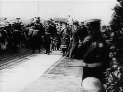 B/W 1900s Czar Nicholas family walking with crowd outdoors / documentary
