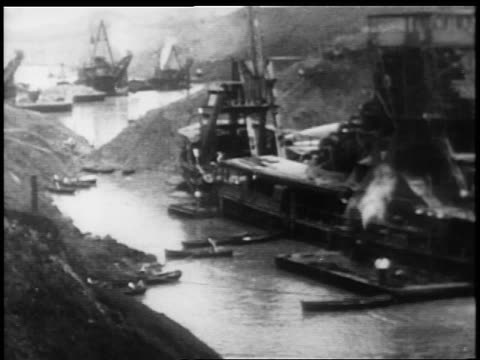 B/W 1900s high angle barges boats in Panama Canal / documentary