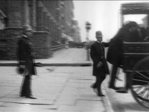b/w 1900s police loading man into paddy wagon / documentary - police force stock videos & royalty-free footage