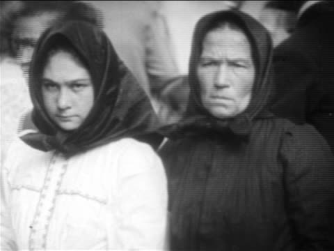 B/W 1900s PORTRAIT 2 solemn immigrant women in babushkas / NYC / newsreel