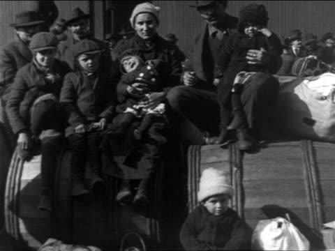 B/W 1900s PORTRAIT immigrant family sitting posing for camera / NYC / newsreel