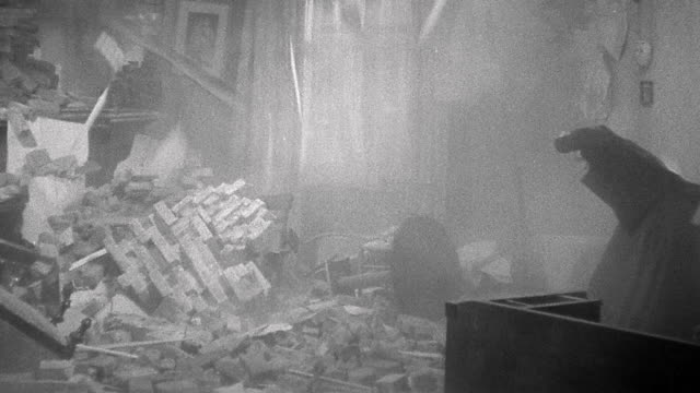 1900s reenactment wide shot woman shields herself from falling debris in rooms during earthquake - rubble stock videos & royalty-free footage