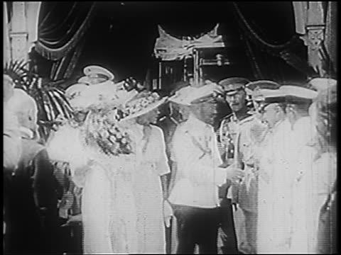 B/W 1900s Russian Czar Nicholas II Czarina Alexandra walking past crowd of officers shaking hands