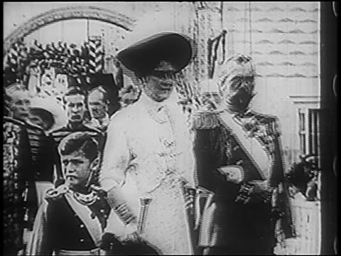 B/W 1900s Russian Czar Nicholas II Czarina Alexandra with boy passing camera with soldiers
