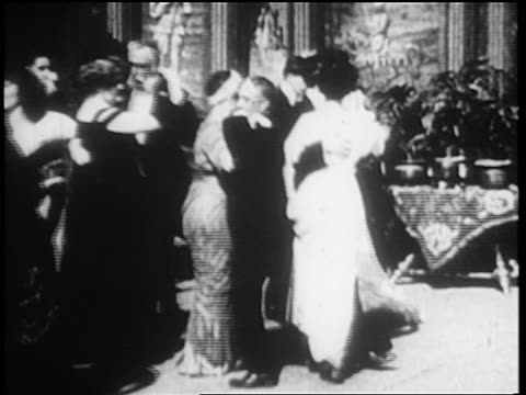 b/w 1900s slow motion people in formalwear waltzing at party - festlich gekleidet stock-videos und b-roll-filmmaterial