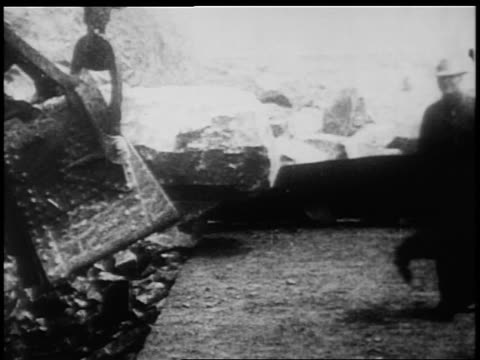 B/W 1900s steam shovel letting down rock in Panama Canal construction / documentary