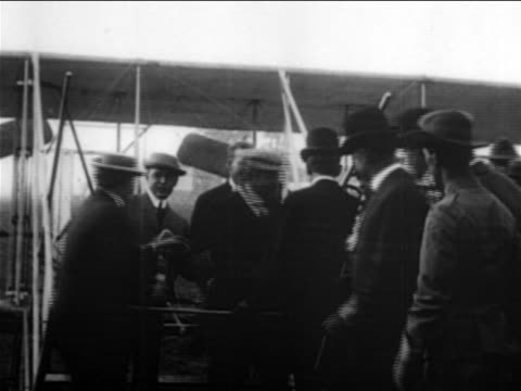 b/w 1900s theodore roosevelt shaking hands with men after riding in wright brothers airplane / doc - theodore roosevelt us president stock videos & royalty-free footage