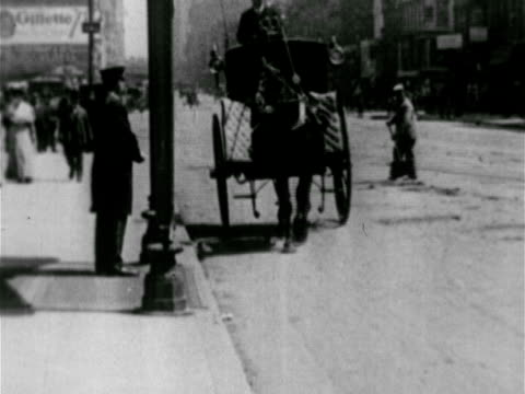 turn of the century city streets ws horse carriage driving down street w/ city worker wepping street bg women cyclists riding bicycles man buying... - mailbox stock videos and b-roll footage