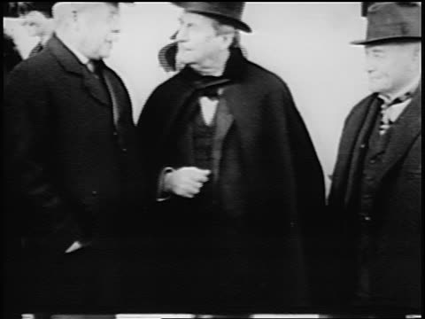 b/w 1900s william jennings bryan in cape standing with senior couple / newsreel - william jennings bryan stock videos & royalty-free footage
