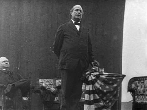vídeos y material grabado en eventos de stock de 1900s william jennings bryan standing at podium giving speech / documentary - only mature men