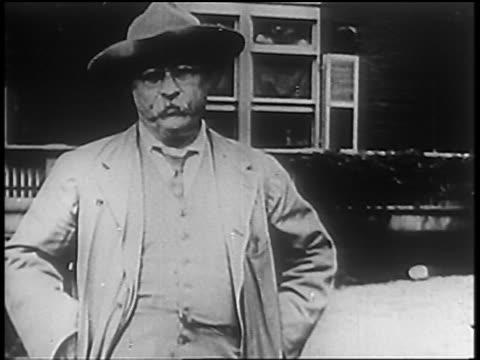 B/W 1900s/10s PORTRAIT Theodore Roosevelt in hat standing outdoors with serious expression