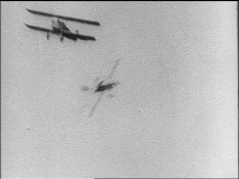 b/w 1910s 2 biplanes flying thru clouds / world war i / newsreel - battle stock videos & royalty-free footage
