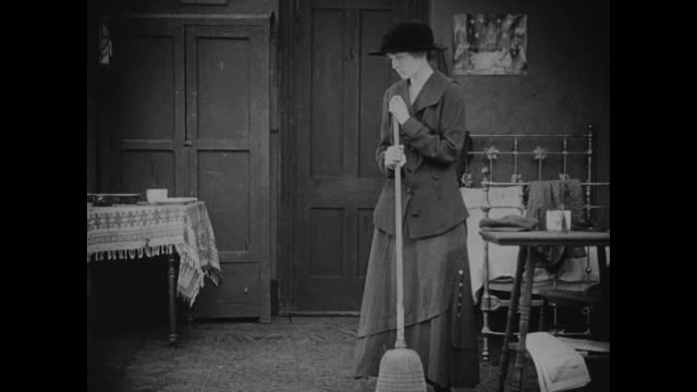 1910s a melancholy woman cleans her apartment - sweeping stock videos & royalty-free footage