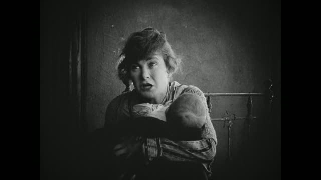 1910s A poor young woman fends off the wealthy women who try to take her baby