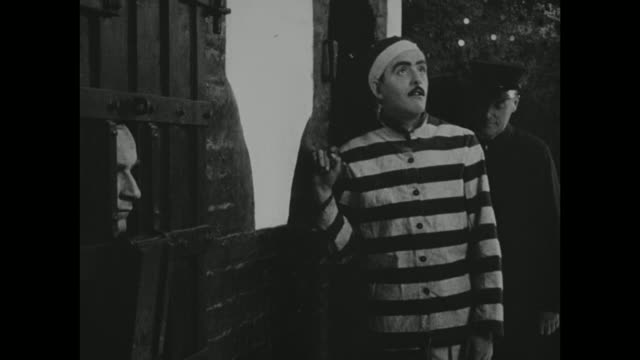 1910s a prisoner acclimates to his new surroundings - 1916年点の映像素材/bロール