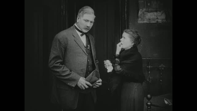 1910s a woman pleads to an investigator - anno 1916 video stock e b–roll