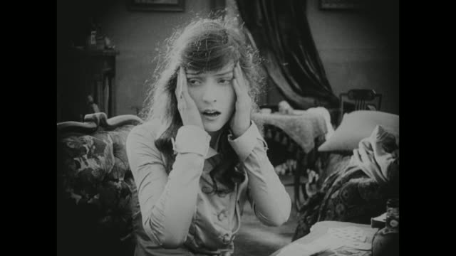 1910s a woman suffers from a range of emotions - silent film stock videos & royalty-free footage