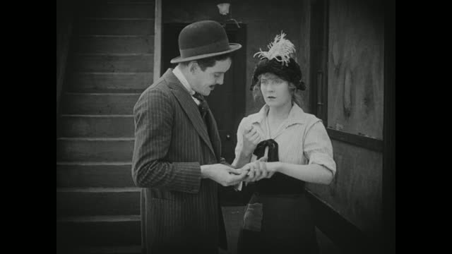 1910s a young woman becomes nervous when an older man reacts positively to her attempts at acting sexy - acting stock videos & royalty-free footage