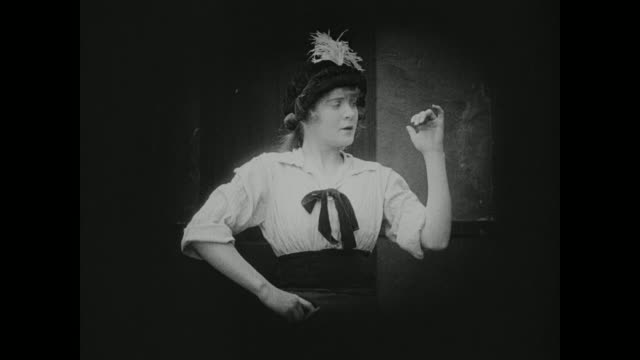 1910s A young woman emulates her stylish role models