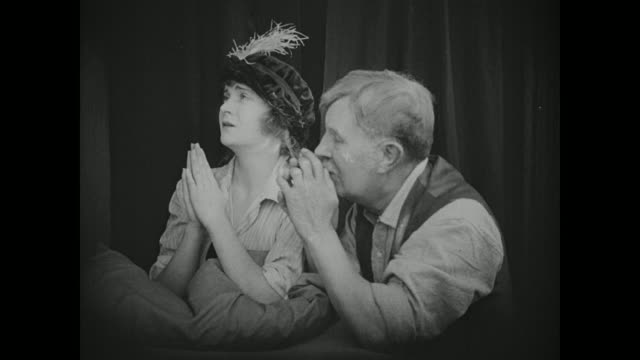 1910s A young woman is forced to pray for forgiveness after being caught with a man