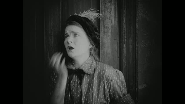 1910s a young woman prays as she struggles with temptation - temptation stock videos & royalty-free footage