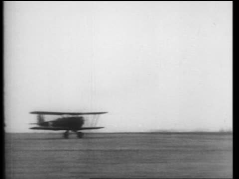 b/w 1910s pan air mail biplane taking off in field / newsreel - propeller aeroplane stock videos & royalty-free footage